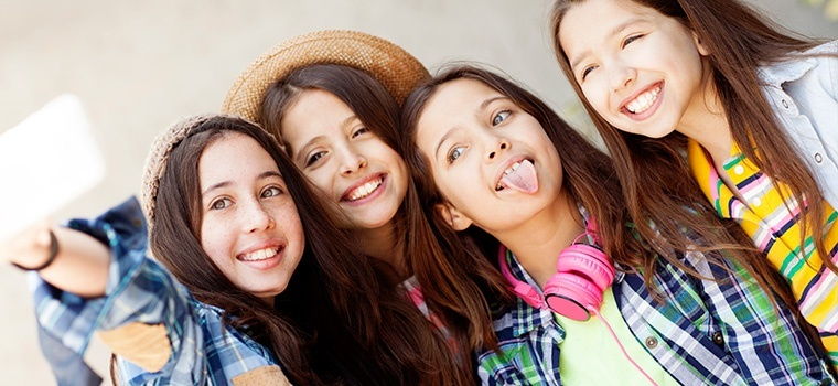 it is common for young females who experience their first menstrual period to:-2